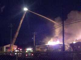 Firefighters reported flames up to 70 feet high leaping from the rooftop when they arrived at the scene.