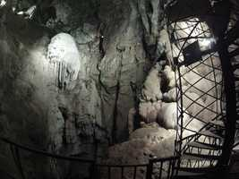 A spiral staircase brings explorers to the cavern floor.