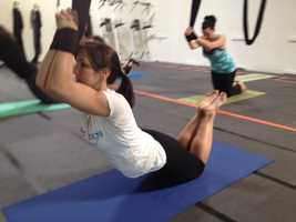 The silks allow beginners to sink deeper into a stretch.