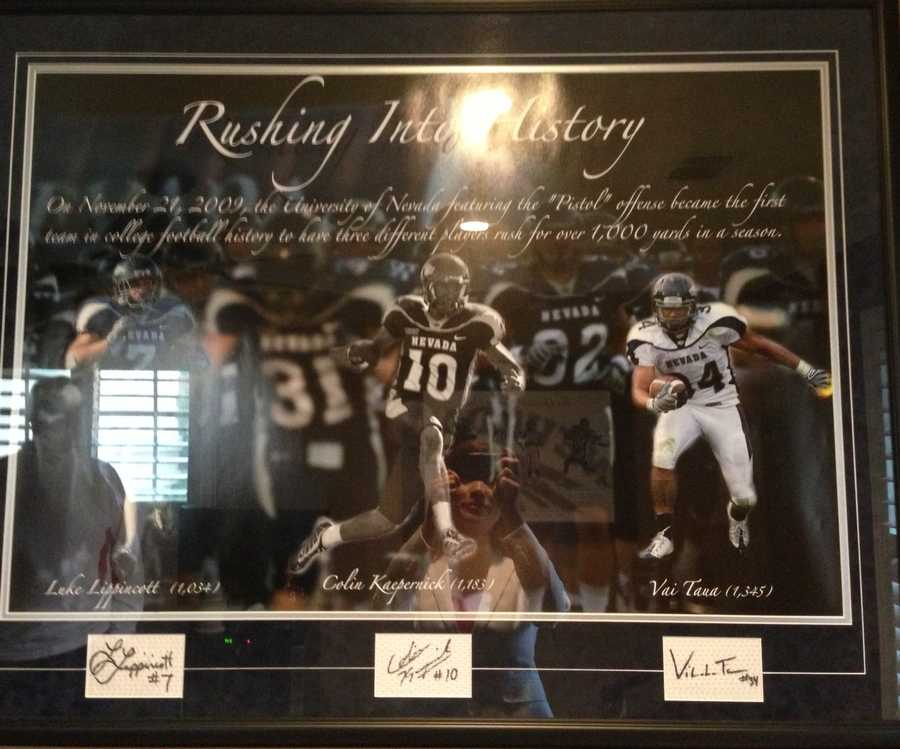 "A framed picture in Colin Kaepernick's parents' home of ""Rushing into History"" from Colin's college football career."