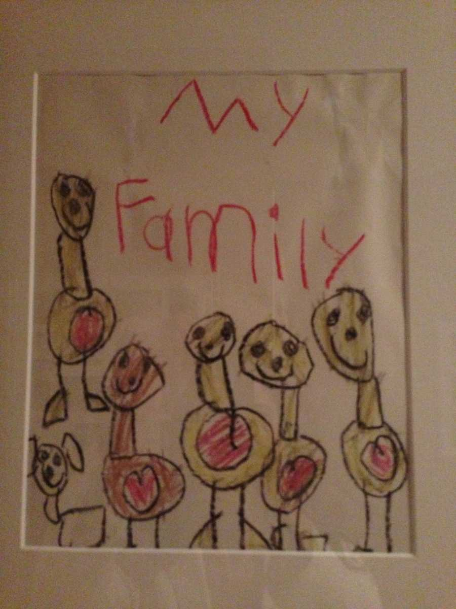"A picture Colin Kaepernick drew of his family when he was preschool age. He was adopted when he was 4 weeks old. His mom says he is biracial: half black, half white. She says Colin was ""heaven sent"" (family photo)."