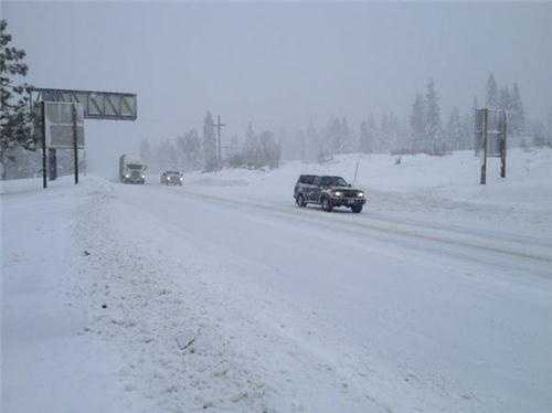 Traffic remains light on Interstate 80 as the snowfall continues.