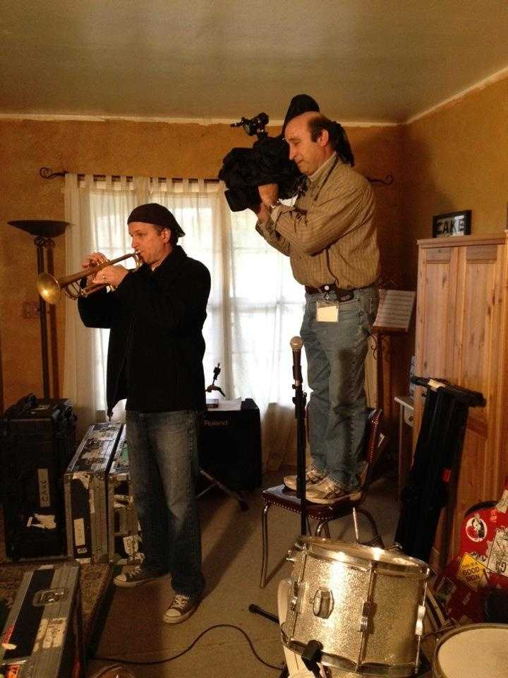 Photographer Larry Blitstein stands on a chair to get the perfect shot for a story on the band Cake that aired in February.