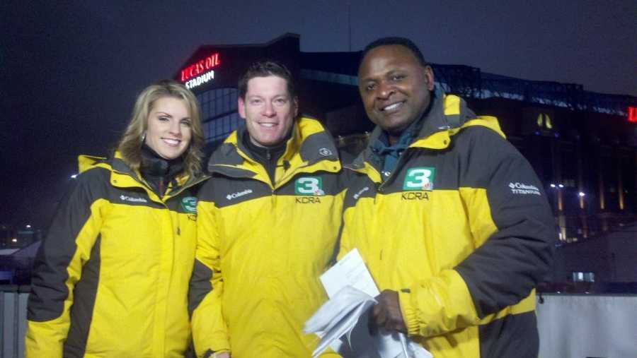 Kellie DeMarco, Chris Riva and Del Rodgers outside Lucas Oil Field Stadium, home of Super Bowl XLVI.