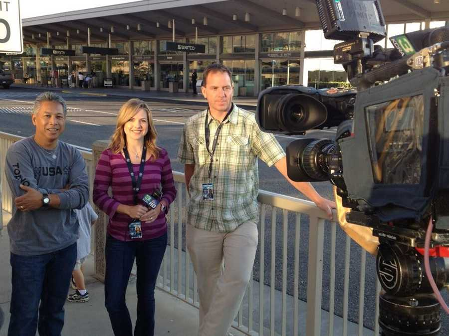 """Deirdre Fitzpatrick, Brian Hickey and Mike """"Domi"""" Domalaog outside Sacramento International Airport before leaving for London."""