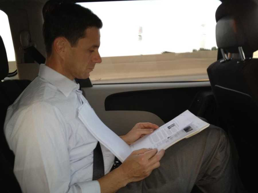 KCRA's David Bienick reads material as he follows the candidates on the campaign trail.