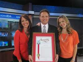 Walt is surrounded by long-time colleagues Deirdre Fitzpatrick and Edie Lambert after his final newscast with KCRA.