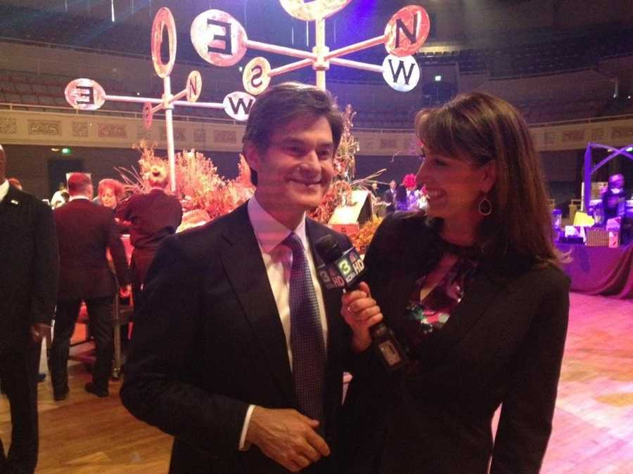 Edie Lambert and Dr. Mehmet Oz share a smile during an interview.