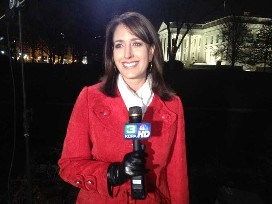 Edie Lambert stands in front of the White House a day before her exclusive interview with President Obama in December.