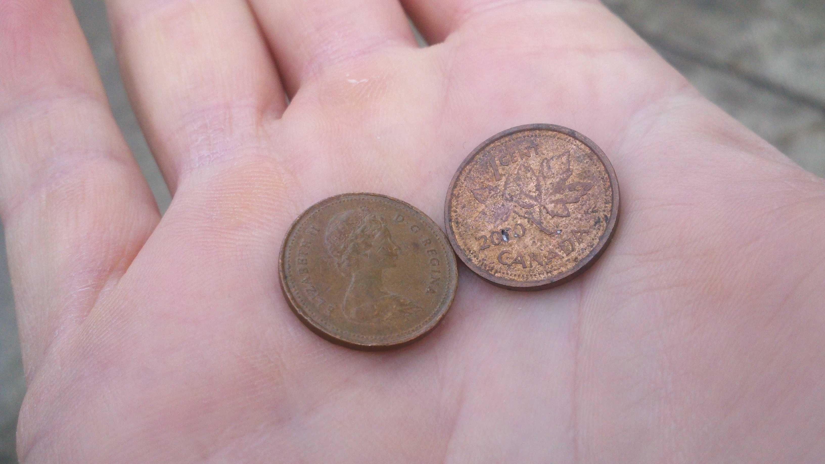 Two Canadian pennies.