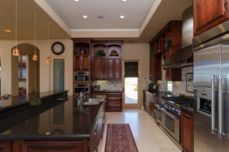 Here's a peek inside the question. This spacious chef's kitchen has a professional range.