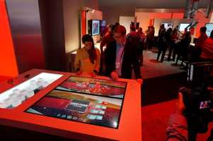 The Verizon booth had this touch/reactive display which changed based on the objects dropped. It was there to help visualize the Verizon services.
