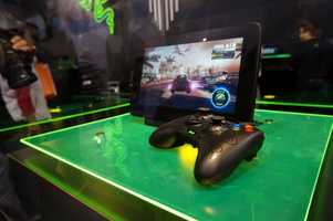 The Edge gaming tablet can be used by itself or connected to a TV.