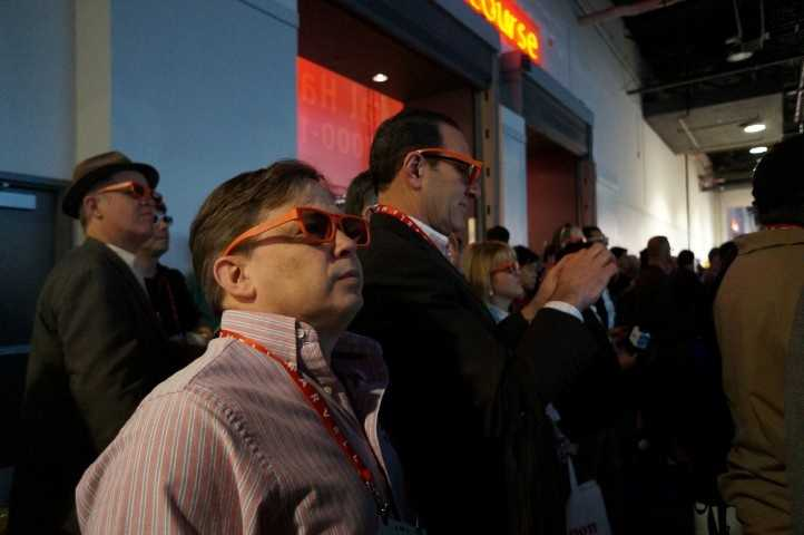 The crowd gathering to watch the 3D LG display.