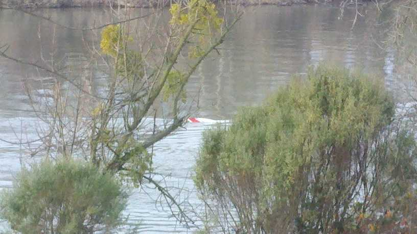 Submerged boat in river