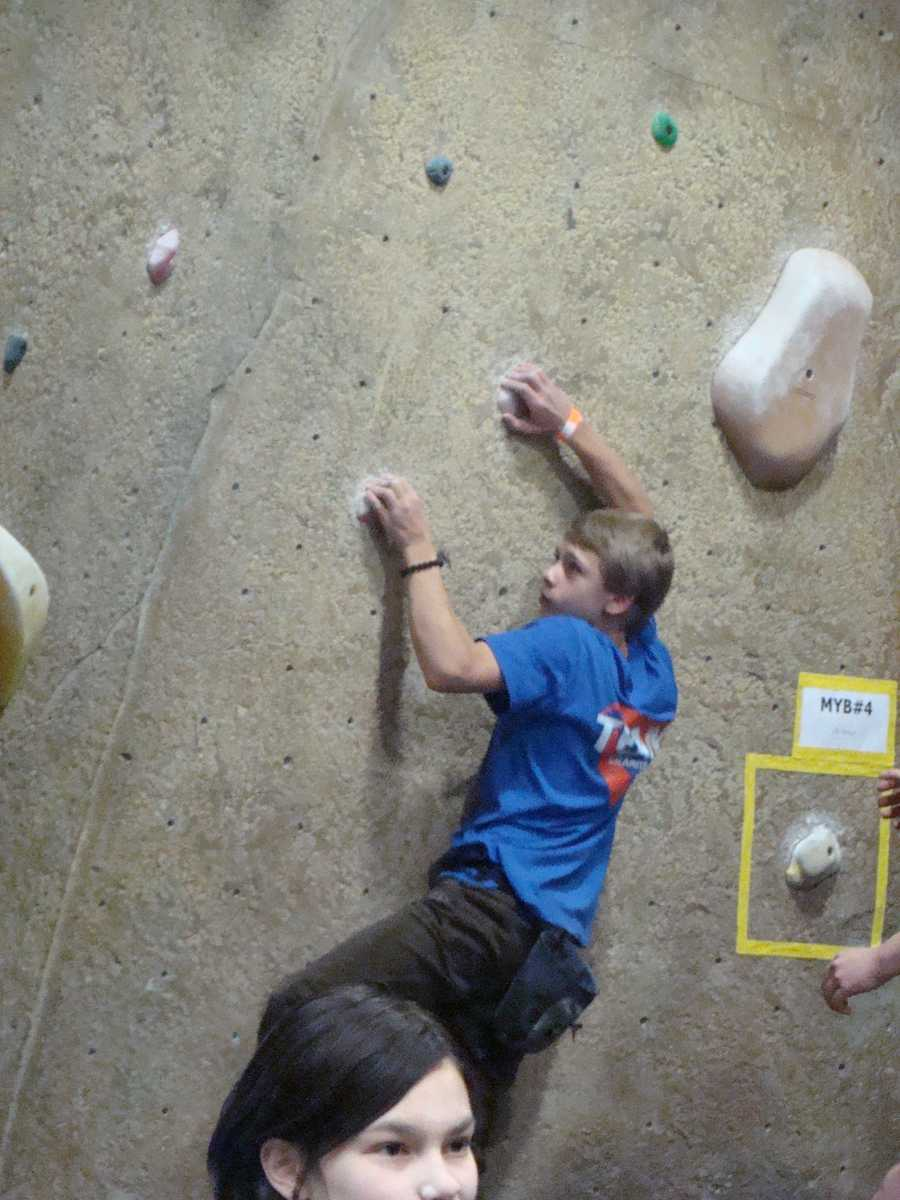 Andrew Christiansen climbing the wall in Tigard, Ore.