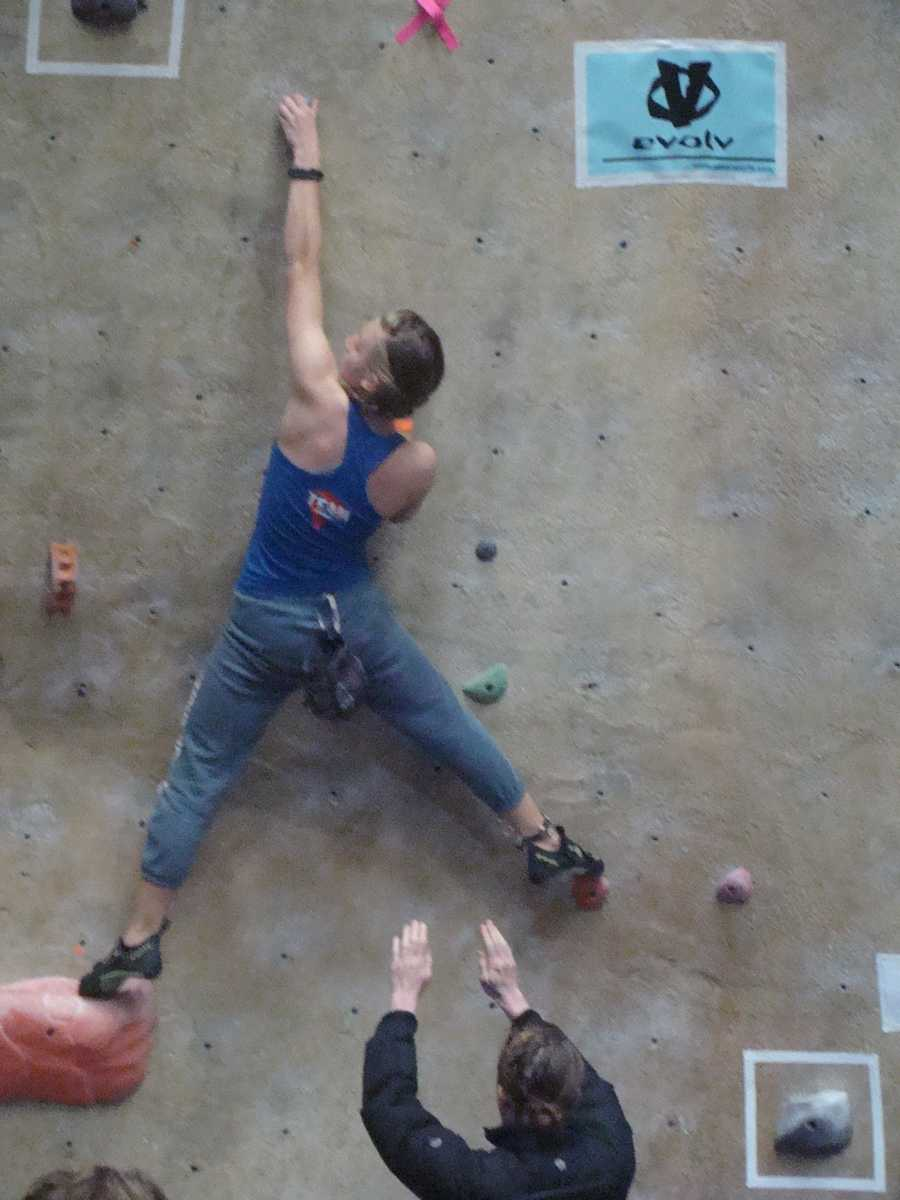 Georgia Richards reaches for the next rock at the competition in Oregon.