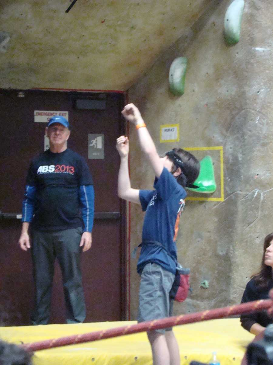 Gabriel Flynn from Granite Arch Climbing Center plans out his hand positions on the wall.
