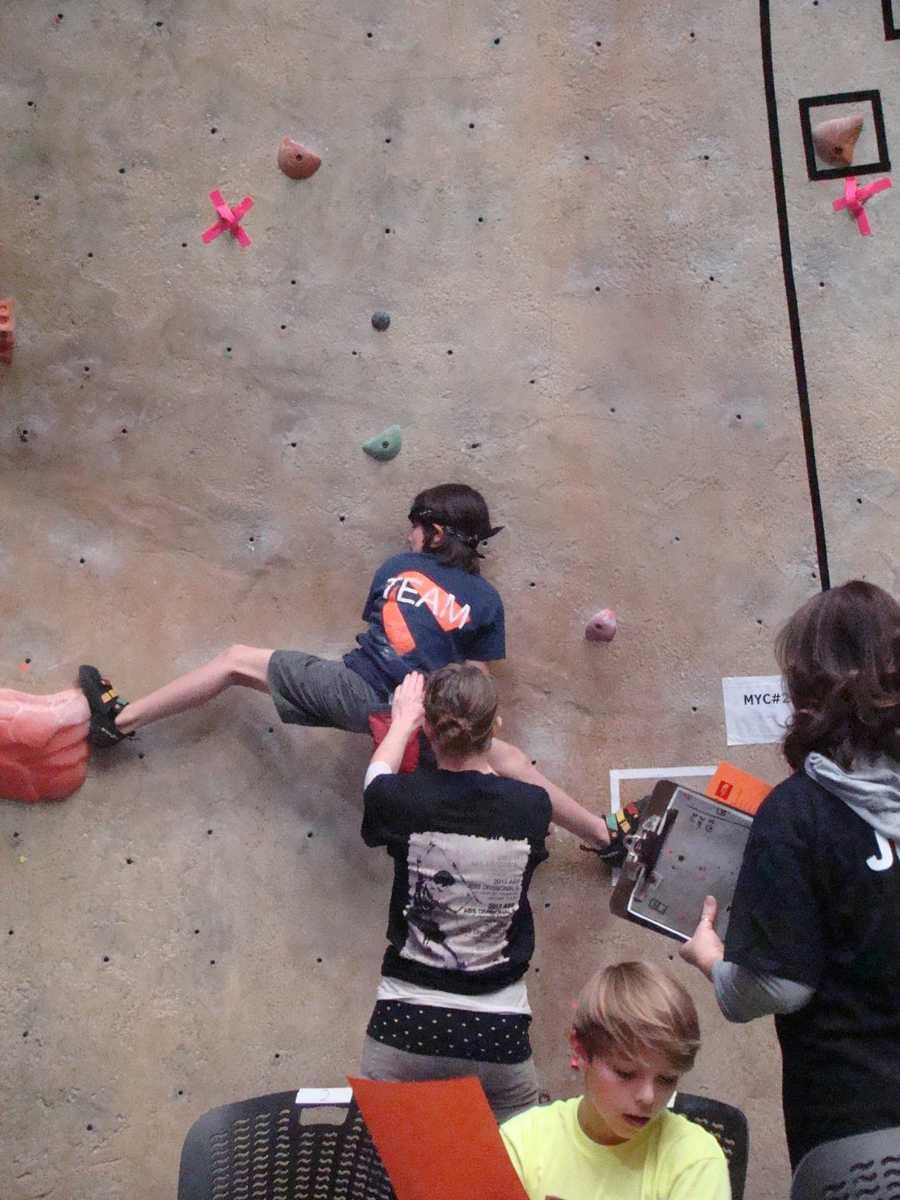 Gabriel Flynn straddles two rocks on the wall in Oregon.