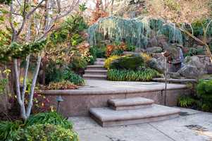 The house features a landscape design and installation by Bushnell Gardens.