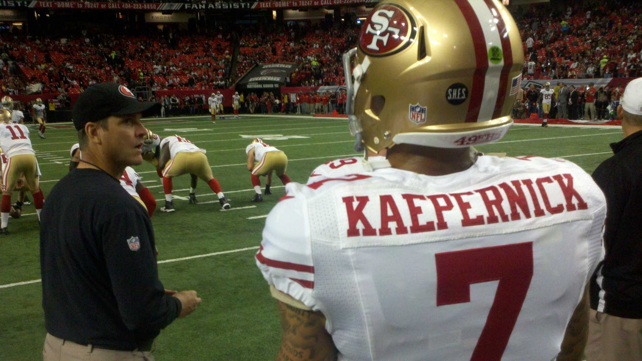 Colin Kaepernick and coach Jim Harbaugh before the NFC Championship game against the Atlanta Falcons. (January 20, 2013)