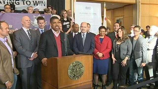 Sacramento Mayor Kevin Johnson appears with a group of local investors at city hall on Jan 23.