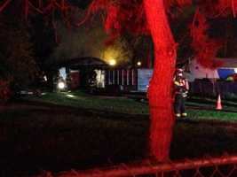 Firefighters responding to a fully involved house fire Tuesday morning had another challenge to deal with after a live power line fell on their fire engine.