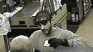 The Roseville Police Department released surveillance photos of the robber.