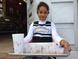 This young cheerleader is selling pralines outside on the steps outside of a shop in New Orleans (Feb. 2, 2013).