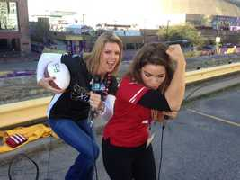 "Kellie and Lisa show off their best ""Kaepernicking"" pose."