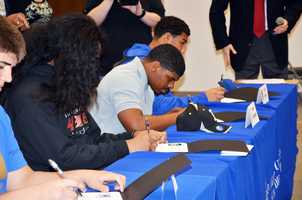 Seniors from Elk Grove area high schools sign to play football in college.