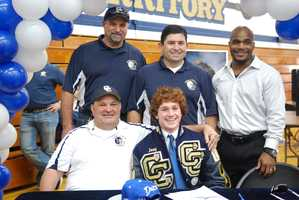 Joey Abbate is pictured with his coaches from Central Catholic High School on National Signing Day.