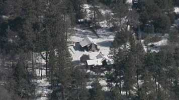 Another look at the cabin in the Seven Oaks development where two deputies were shot. One of the wounded officers is expected to survive, the other has died.