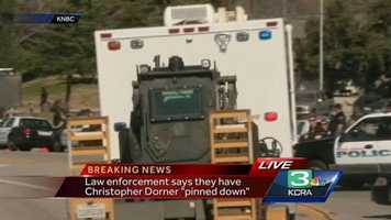 """An assault vehicle in transit to where law enforcement reports they have Christopher Dorner """"pinned down""""."""