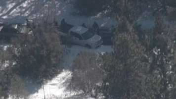 """Law enforcement check vehicles near the cabin where authorities claim to have ex-cop Christopher Dorner """"pinned down""""."""