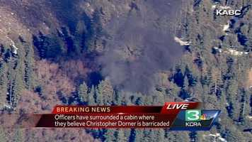 A fire burning near the location of the search for ex-LAPD Christopher Dorner.