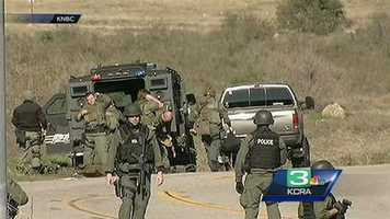 Law enforcement putting on gear at one of the staging areas.