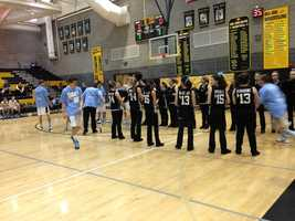 Del Oro cheerleaders form a tunnel for the Golden Eagle boys basketball team during the school's Anti-Bullying basketball game.