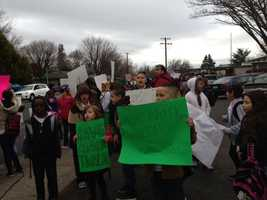 Parents and students gathered to protest the planned closure of Mark Twain Elementary School on Tuesday. (Feb. 19, 2013)