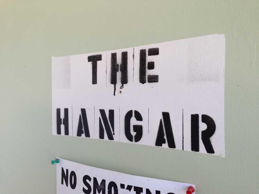 A sign hangs on the door to recording studio at the Hangar.