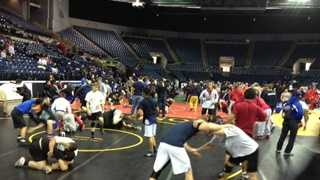 Hundreds of high school wrestlers prepare for competition at the CIF Sac-Joaquin Masters wrestling tournament.