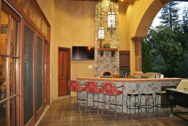 The home is perfect for entertaining. Here, a bar and BBQ are front and center. The home has about 3,560 square feet of outdoor entertaining space.