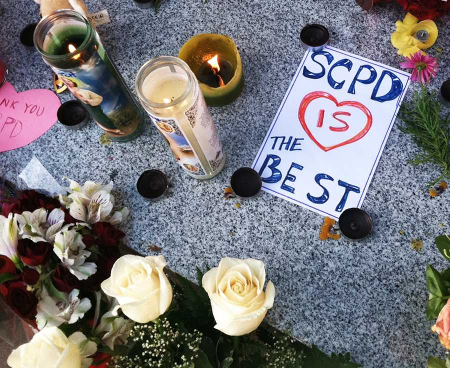 A memorial of candles and flowers grew throughout Tuesday night and Wednesday morning outside the Santa Cruz Police Station. (Feb. 27, 2013)