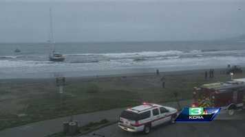 An 82-foot sailboat has washed ashore at Pacifica State Beach and is trapped in shallow water at low tide and unable to get back out to sea.