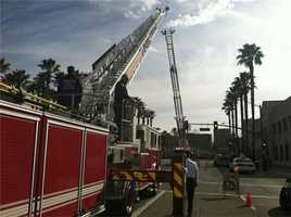 San Jose and Santa Cruz fire trucks make a ladder crossing.