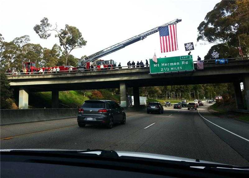 This morning a convoy of several hundred emergency vehicles began at the Santa Cruz Beach Boardwalk, traveled over the Santa Cruz mountains on Highway 17, and arrived at the HP Pavilion in San Jose at 10 a.m.