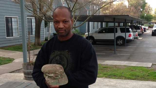 Sgt. Cecil Edwards shows a cap, one of the few items thieves left behind (March 8, 2013).