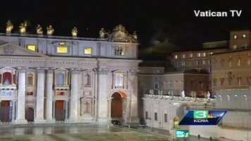 White smoke rising in the distance from the Sistine Chapel indicating a new Pope has been selected.