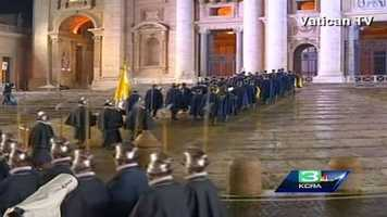 The Swiss Gaurd move to their post just outside St. Peter's Basilica.