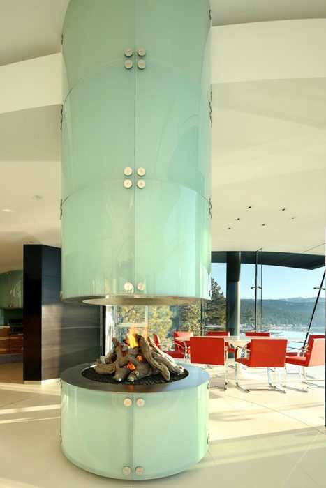 The home has this circular fireplace.
